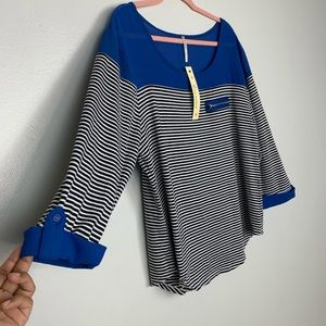 royal blue, black and white long sleeves tshirt